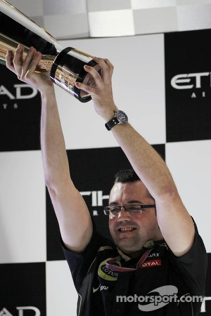 Eric Boullier, Lotus F1 Team Principal celebrates on the podium