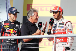 Mario Andretti, with Lewis Hamilton, McLaren and Sebastian Vettel, Red Bull Racing on the podium