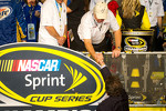 Championship victory lane: Roger Penske (wearing a Hendrick Motorsports hat) is congratulated by Mike Helton