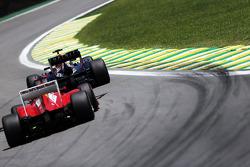 Mark Webber, Red Bull Racing leads Fernando Alonso, Ferrari