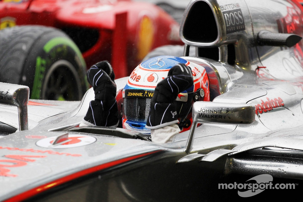 Race winner Jenson Button, McLaren celebrates in parc ferme