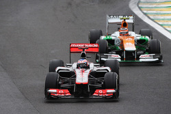 Jenson Button, McLaren leads the race from Nico Hulkenberg, Sahara Force India F1