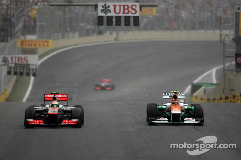 Lewis Hamilton, McLaren Mercedes and Nico Hulkenberg, Sahara Force India Formula One Team