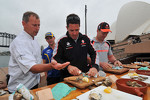 Jamie Whincup and Craig Lowndes taking part in the Ford vs Holden challenge on Sydney Harbour