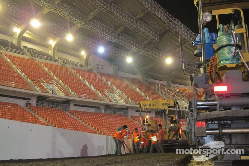 Crews build the track