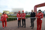 Felipe Massa and Fernando Alonso unveil the new art installation at the Ferrari facility