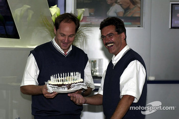 Head of BMW motorsport Dr. Mario Theissen gives a birthday cake to Gerhard Berger
