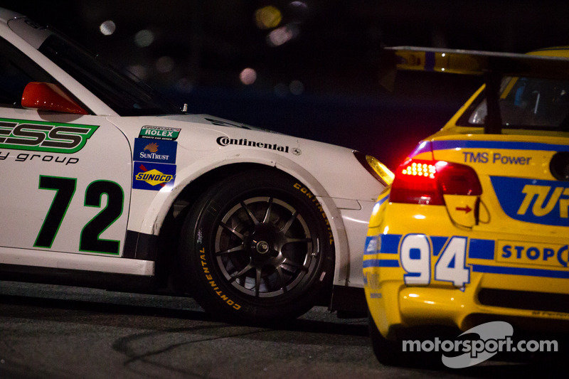 #72 Park Place Motorsports Porsche GT3: Chuck Cole, Grant Phipps, Mike Vess, Alex Whitman spins in front of #94 Turner Motorsport BMW M3: Bill Auberlen, Paul Dalla Lana, Boris Said