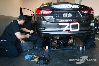 Mazdaspeed Speedsource team members work on the #70 Mazdaspeed Speedsource Mazda6 GX