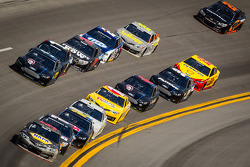Martin Truex Jr., Michael Waltrip Racing Toyota leads a group of cars