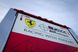 AIM Motorsport Racing with Ferrari transporter