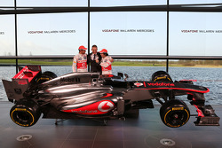 Jenson Button, McLaren with Martin Whitmarsh, McLaren Chief Executive Officer and Sergio Perez, McLaren with the new McLaren MP4-28