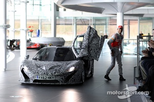 Jenson Button arrives in a McLaren P1 prototype