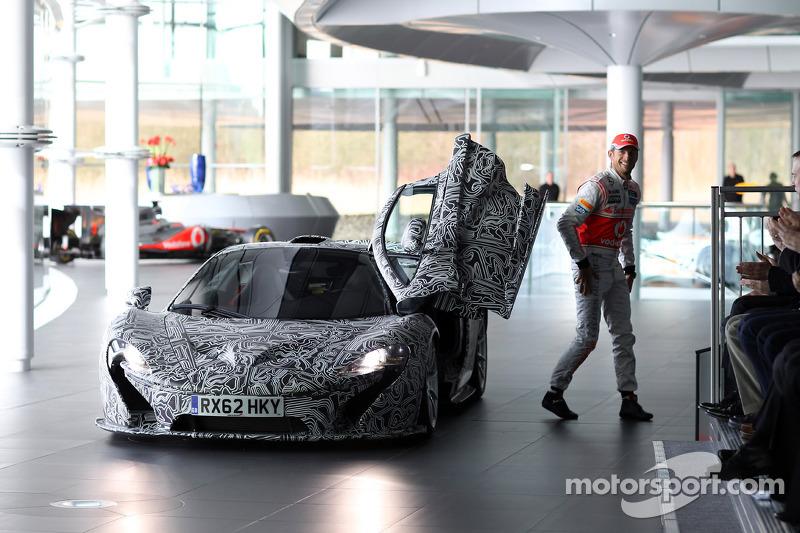Jenson Button arrives in a McLaren P1 prototype