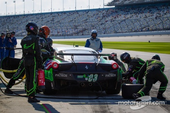 Pit stop for #03 Extreme Speed Motorsports Ferrari 458: Ed Brown, Mike Hedlund, Scott Sharp, Johannes van Overbeek