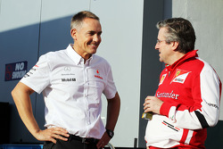 Martin Whitmarsh, McLaren Chief Executive Officer with Pat Fry, Ferrari Deputy Technical Director and Head of Race Engineering