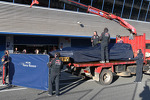 The Scuderia Toro Rosso STR8 of Daniel Ricciardo, Scuderia Toro Rosso is recovered back to the pits on the back of a truck