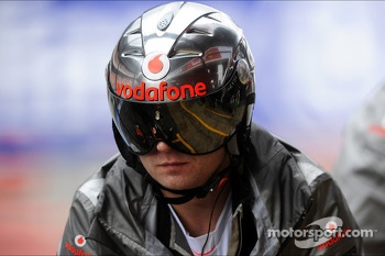 McLaren mechanic with pit stop helmet