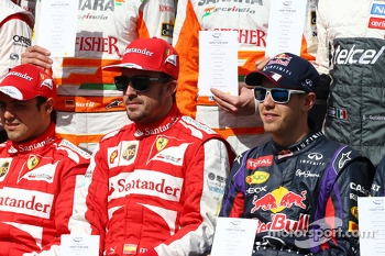 (L to R): Fernando Alonso, Ferrari and Sebastian Vettel, Red Bull Racing at the drivers start of year photograph