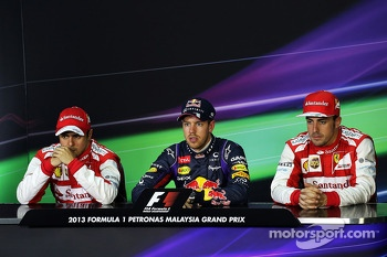 The top three qualifiers in the FIA Press Conference: Fernando Felipe Massa, second; Sebastian Vettel, Red Bull Racing, pole position; Fernando Alonso, Ferrari, third