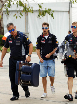 Sebastian Vettel, Red Bull Racing with Heikki Huovinen, Personal Trainer, and Paul Cheung, Red Bull Racing Team Chiropractor