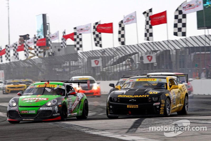 Jack Baldwin, GTSport Racing/Porsche Cayman S leads Andy Lee, Best IT Racing Chevrolet Camaro into Turn 1
