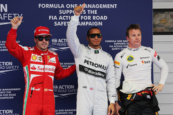 The top three qualifiers in Parc Ferme, Ferrari, third; Lewis Hamilton, Mercedes AMG F1, pole position; Kimi Raikkonen, Lotus F1 Team, second