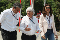 Pasquale Lattuneddu, of the FOM with Bernie Ecclestone, CEO Formula One Group, and his fiance Fabiana Flosi