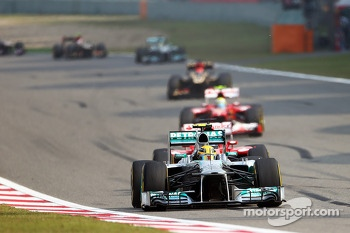 Lewis Hamilton, Mercedes AMG F1 W04 leads at the end of the opening lap of the race