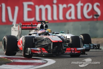 Jenson Button, McLaren MP4-28 leads Lewis Hamilton, Mercedes AMG F1 W04