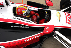 Helio Castroneves in A.J. Allmendinger's car