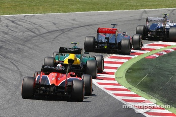 Valtteri Bottas, Williams FW35; Jenson Button, McLaren MP4-28; and Giedo van der Garde, Caterham CT03