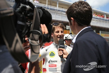 Romain Grosjean, Lotus F1 Team and Thomas Sénécal, Canal +