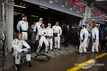 Schubert Motorsport team members wait for a pit stop