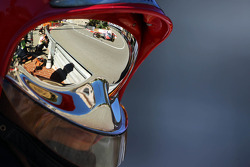 Jenson Button, McLaren MP4-28 reflected from a fireman's helmet visor