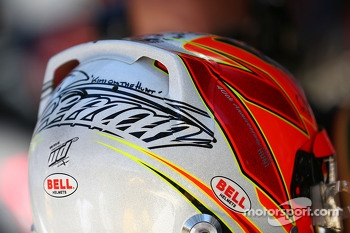 The helmet of Kimi Raikkonen, Lotus F1 Team on the grid as the race is stopped