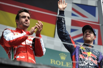 Race winner Sebastian Vettel, Red Bull Racing celebrates on the podium with second placed Fernando Alonso, Ferrari