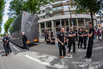 Lotus Praga team members arrive at scrutineering