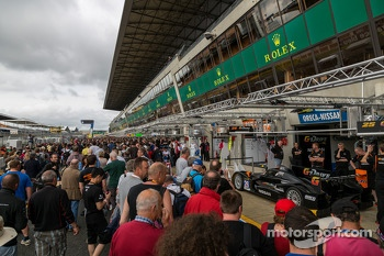 Fans in pit lane during autograph session