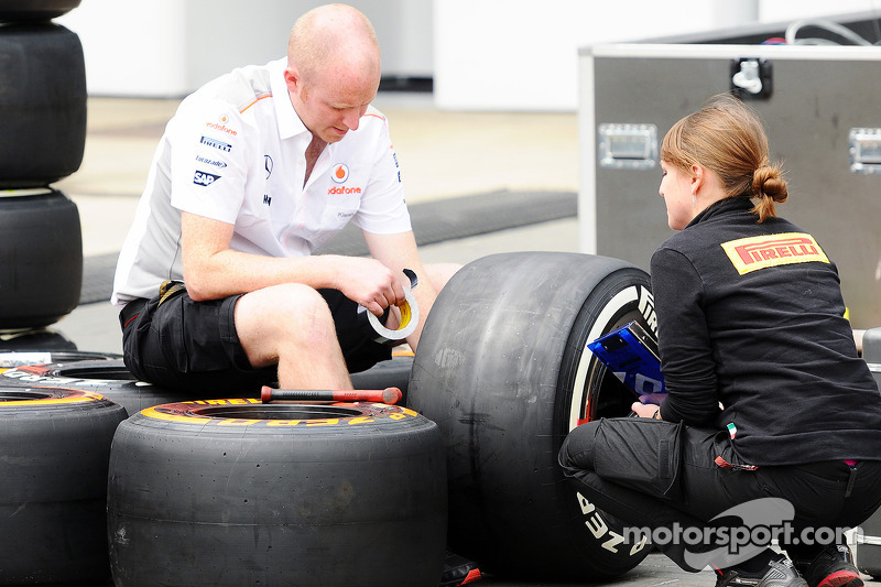 McLaren mechanic with a Pirelli Tyre Engineer.