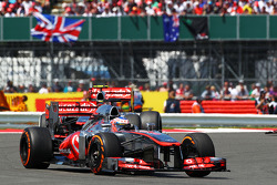 Jenson Button, McLaren MP4-28 leads Sergio Perez, McLaren MP4-28