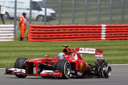 Felipe Massa Ferrari F138 returns to the pits with a punctured rear Pirelli tyre