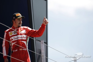 Fernando Alonso Ferrari celebrates his third position on the podium
