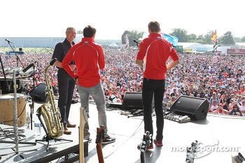 Tony Jardine, Jules Bianchi Marussia F1 Team and Max Chilton Marussia F1 Team at the post race concert