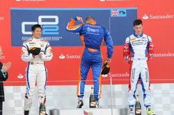 Podium race 2: winner Jon Lancaster, second place Rio Haryanto, third place James Calado