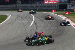 Giedo van der Garde, Caterham CT03 leads Jean-Eric Vergne, Scuderia Toro Rosso STR8