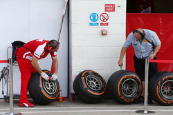 Ferrari mechanic and Pirelli tyre technician check used Pirelli tyres