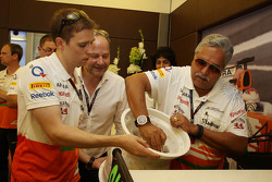 Dr. Vijay Mallya, Sahara Force India F1 Team Owner signs a ceramic wheel rim to be presented to Adrian Sutil, Sahara Force India F1 for his 100th GP
