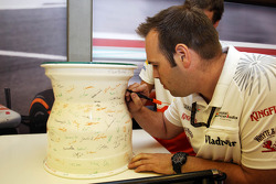 A ceramic wheel rim, signed by the team, to celebrate 100 GP starts for Adrian Sutil, Sahara Force India F1