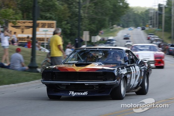 Race cars parade into Elkhart Lake for the Friday concours. #42 1970 Plymouth 'Cuda: Andy Boone